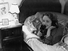 Erich Salomon ::   German-born actress and singer   Marlene Dietrich   making a telephone call to her daughter from her bed in Hollywood, 1920′s [Getty Images]