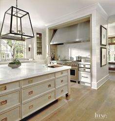 Contemporary White Kitchen with Geometric Chandelier