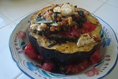 Roasted Acorn Squash Stuffed with Sauteed Greens, Tomatoes, and Goat Cheese