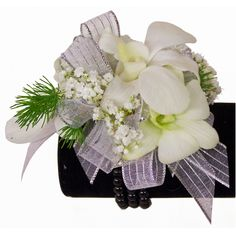 """This tropical beaded beauty wristlet corsage is adorned with dendrobium orchids in either purple, white, or purple and white """"Bombay"""" colors. Bracelet available in multiple colors."""