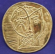 Pablo Picasso gold circular pendant; image credit on full record