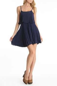pretty navy pleated dress.
