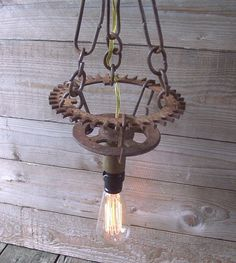 Vintage Cast Iron Gears Steampunk Industrial Chandelier Hanging Lamp. $125.00, via Etsy.