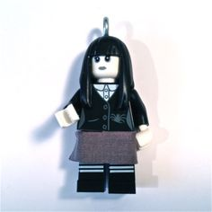 "Hello to Goth Girl from the LEGO Minifigure Collector Series 12.   Sometimes she is also known as Wednesday from the Adams Family!  She is fully posable and is accompanied by an 18"" matching Bead Necklace chain that is made in USA.  She is also available as a High Quality Key Chain, you decide.             This item is intended for decorative purposes and is not a toy.  LEGO® is a trademark of the LEGO® Group. This site is neither owned nor operated by LEGO® Systems, Inc. and is in no way… Necklace Chain, Beaded Necklace, Lego Jewelry, Lego Girls, Lego System, Adams Family, Lego Group, Lego Minifigure, Goth Girls"