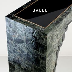 Detail of our Joe Console in green mica and black lacquer. Designed by Jallu, mica furniture, green mica furniture, green furniture, Jallu Creations 2021, interior design, one of a kind furniture, french craftsmanship, bespoke furniture, custom furniture, made in France, interior design inspiration, design inspiration