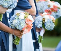 Blue hydrangeas, coral lilies and white ranunculus make up these delicate, nautical-inspired bouquets.