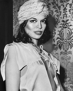 Bianca Jagger: Super stylish wife of Mick Jagger. She wore lots of low cut tops like this one and the low v-front suit she wore on her wedding day. Turbans also made a comeback in the 70s, and Bianca is rocking it.