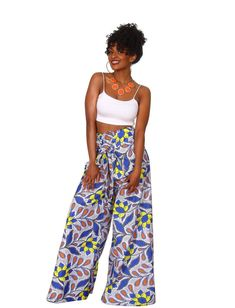 23 Must-Have African Pants to Rock This Year and Beyond! African Clothing For Sale, African Dresses For Women, African Print Pants, African Print Fashion, Printed Maxi Skirts, Printed Pants, Ghanaian Fashion, Floral Pants, African Fabric