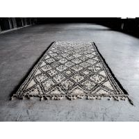 Amazing vintage berber rug made by beni ouarian tribe.