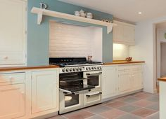 We love this Smeg Victoria cooker. Would like to build in a faux fireplace feature like this (but in painted brick), with the display shelving on top. Cream cooker, white cabinets, grey caesarstone bench top. Shelves on the inside for spices