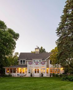 This home, decked out for summer, was built to intentionally rooms like the kitchen, porch and sunroom to the water. French Bistro, Lawn Chairs, Lake Cabins, Ship Lap Walls, Back Patio, Minnesota, Beautiful Homes, Mansions, House Styles