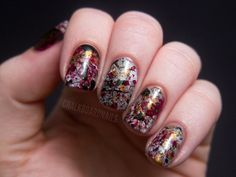 """Sara of Chalkboard Nails calls this look the """"creepy splatter."""" To achieve the Pollock-esque effect, she cuts some drinking straws in half, dunks them partially into a bottle of polish and carefully blows the polish onto her nails!  Filed Under:DIY, nails"""