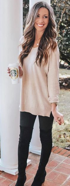 white long-sleeved shirt and black fitted pants