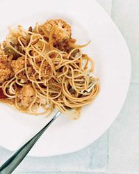 "Spaghetti with Cauliflower | For Michael Psilakis, macaronia (""pasta"") has always meant chicken stewed with spaghetti, tomatoes, cinnamon, raisins and pine nuts. Those are the dominant ingredients here, except he's substituted chicken with cauliflower."