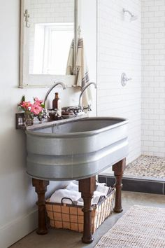 Take a cue from this homeowner and upcycle a large tub to make a double sink, or use a small tank for a teeny bathroom. See more ideas from this rustic cabin in Tennessee.