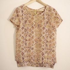 Anthropologie Fynn and Rose Silk snake skin blouse 100% silk blouse from Anthropologie. It's a snake skin print in beautiful pinks and beiges. In perfect condition and love the back zipper detail! Anthropologie Tops Blouses