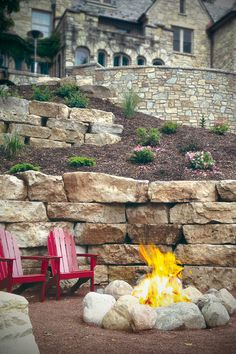 Beautiful lake home stone wall boulders in landscape design for dry stacked stone retaining wall full thin stone veneers & fire pit rocks / stone surround. Fire Pit Landscaping, Landscaping Retaining Walls, Landscaping With Rocks, Landscape Design, Garden Design, Landscape Mode, Landscape Photos, Stone Facade, Gardens