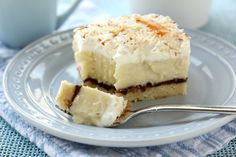 Chocolate & Coconut Cream Pie Bars with coconut cream filling and chocolate ganache layer on Willow Bird Baking