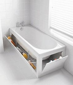Good idea. now if the tub was five times larger you could bathe more than little people. bathroom space savers, bathtub with storage shelves, storage solutions