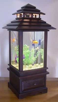 Custom-made wooden fish tank with Bali-style roof.: