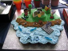 Inspiration for a pirate island cupcake scene. Substitute the Dora with Peter Pan, Capt. Hook, Tic-Toc Croc and Jake.