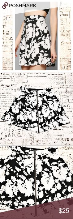 Urban Outfitters Pins Needles Zip Front Mini Skirt This skirt by Pins and Needles is so sweet! Zipper front closure and elastic strip along center of back waistband for guaranteed perfect fit. Beautiful black and white floral print. Urban Outfitters Skirts Mini