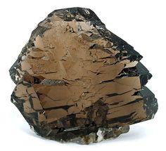 : Quartz (Var.: Smoky Quartz)  Locality: Giuv Valley, Tujetsch (Tavetsch), Vorderrhein Valley, Grischun (Grisons; Graubünden), Switzerland (Locality at mindat.org)  Size: 5.8 x 4.9 x 2.1 cm.  This specimen is water clear and has a sparkling glassy lustre. For the size, this gemmy, brilliantly sparkling gwindel (twisted) smoky quartz is superb. Ex. Helmut Bruckner Collection.