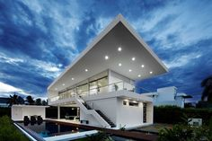 Colombian studio GM Arquitectos has designed the GM1 House.  Completed in 2011, this two story contemporary home is located in Girardot, Colombia.