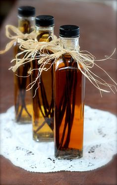 Homemade vanilla extract!  Gorgeous gift idea...  Might try bourbon instead of vodka?  Is that how bourbon vanilla extract is made?
