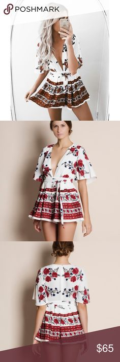 """Paradiso Red / White Floral Romper White floral romper with a splash of red florals. Junior sizing. Brand new with tags. This is an ACTUAL PIC of the item - all photography done personally by me or is an official brand collaboration. Model is 5'8"""" 34""""-25""""-36"""". NO TRADES DO NOT BOTHER ASKING. PRICE FIRM. Bare Anthology Pants Jumpsuits & Rompers"""