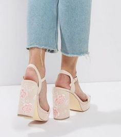 - Floral embroidered finish- Open toe- Block heel- Ankle strap fastening