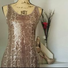 Sequin Dress Stunning Sparkly Sequin dress by Joseph Ribkoff. Crackled pattern detail on front embellished by marbled goldish sequin. Show stopper dress and will make you feel fabulous!! EXCELLENT CONDITION! ! Joseph Ribkoff Dresses