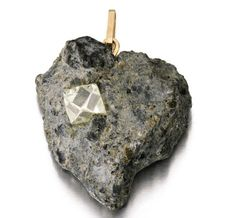 Gina Lollobrigida's heart-shaped pendant, carved out of the kimberlite mass in which the rough 6ct octahedron diamond was found. It was given to her by Harry Oppenheimer to commemorate the fact that, on the day Gina visited, the world's ninth-largest diamond was discovered in the very same mine