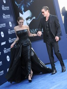 Brad Pitt and Angelina Jolie. At the world premiere of Maleficent.   - ELLE.com