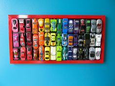 DIY Rainbow Car Wall Art - use your old Matchbox and Hot Wheel cars to make art for you kid's room!