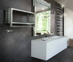 #Montecarlo Design by Peter Jamieson. In this photo Montecarlo is in a bathroom display inside Morandi's showroom (http://www.morandispa.com) in Modena.  In the wall Starlike by Litokol (www.litokol.it).   #Tubesradiatori