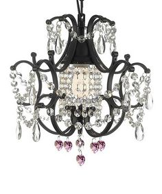 Illuminate a room in an elegant manner with this classically designed chandelier. This ornate piece will add royal flair to a dining room and look magnificent hanging over a banquet prepared for friends and family.