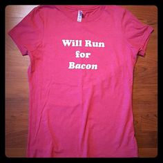 Will Run For Bacon Tee This tee gets SO many compliments, but it doesn't fit me anymore.     Tag says Medium but fits like Small.  100% cotton. Made in USA. Smoke-free home. bella Tops Tees - Short Sleeve