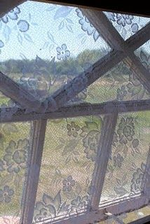 Pretty lace instead of ugly mosquito netting for windows. Seen in the workshop of a Swedish artist on Gotland.