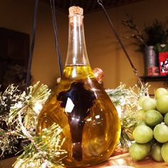 This gorgeous glass cruet holds both your favorite olive oil and balsamic vinegar and makes a stunning and impressive centerpiece!