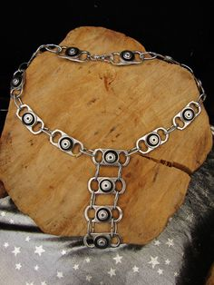 Chain link recycled can tab long necklace with black rubber. $32.00, via Etsy.