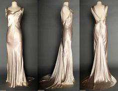 """SILVER SATIN EVENING GOWN, 1930s  Silver-pale lavender silk charmeuse bias-cut sleeveless gown, cowl neckline, open back, jeweled Deco elements on shoulder straps & at CB, floating trained back panel, labeled """"NRA Code, Made Under Dress Code Authority PHB038577"""", B 34""""-36"""", H 35""""-38"""", L62""""-72"""", (belt missing, 3 tiny tears on front, stains & grime at hem) fair. Augusta Auctions. April 9, 2014 - NYC New York City"""
