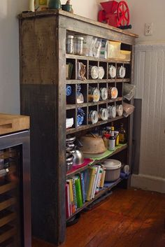 I love how old and rustic the shelving looks.  But it all seems come alive because of the things in it.