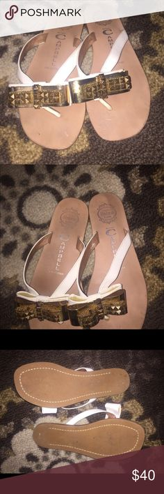 Jeffrey Campbell White & Gold Sandals Jeffrey Campbell ESME-MB 6 White & Studded Bow Gold Sandals. Bows recently repaired at cobbler for reinforcement. Hardly worn and minor wear. Please ask questions and see Pictures. Size 6 Jeffrey Campbell Shoes Sandals
