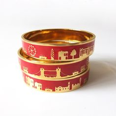 These colorful, gold-plated bangles feature landmarks big and small.
