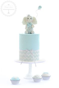 Baby shower cake with baby elephant topper hand crafted from fondant