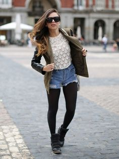 Shorts with tights! gorgeous combo with a lacy shirt for a feminine feel, along with the edgy statement leather jacket.