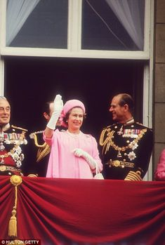 Happy and glorious: The Queen and Duke of Edinburgh greet the crowd from the Palace balcony