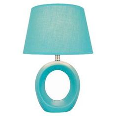 Retro-inspired blue ceramic table lamp. Product: Table lamp  Construction Material: Ceramic  Color: Blue  Features:   On/off socket switch  Retro style  Accommodates: (1) 60 Watt incandescent bulb - not included   Dimensions: 23.25 H x 12.5 W x 13 D