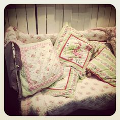 Cath Kidston inspired cushions and linens.